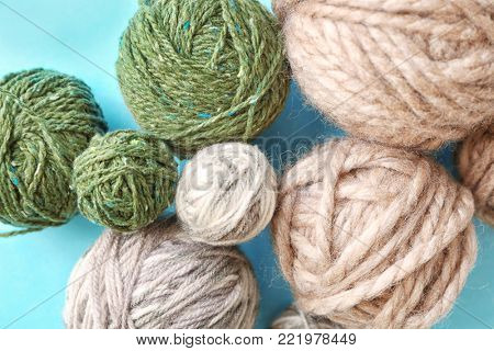 Set of woolen clews on color background, top view