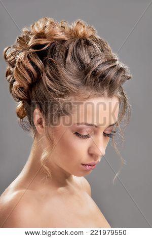 Beautiful sensual blonde woman with elegant wedding hairstyle