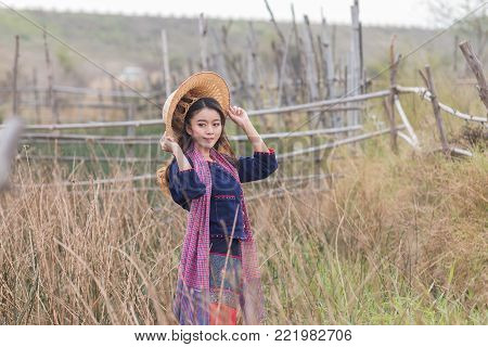 beautiful woman thai traditional culture, Asian woman wearing traditional Thai culture at  countryside.