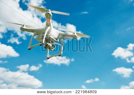 drone hovering in blue sky