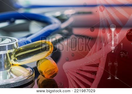 drug and stethoscope on the table and red chromosome concept healthcare