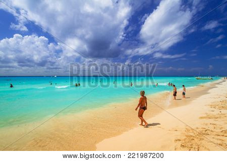 PLAYA DEL CARMEN, MEXICO - JULY 11, 2011: People on the beach of Playacar at Caribbean Sea, Mexico. This resort area is popular destination with the most beautiful beaches.