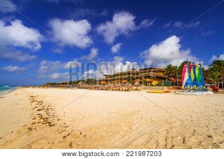 PLAYA DEL CARMEN, MEXICO - JULY 11, 2011: Colorful sail catamarans on the beach of Playacar at Caribbean Sea of Mexico. This resort area is popular destination with the most beautiful beaches.