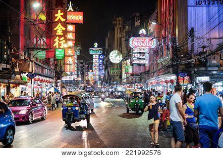 CHINATOWN, BANGKOK, THAILAND - 9 JANUARY, 2016: Tourist walking along both side of Yaowarat Road at night, Bangkok Chinatown, for delicious street food in Bangkok, Thailand