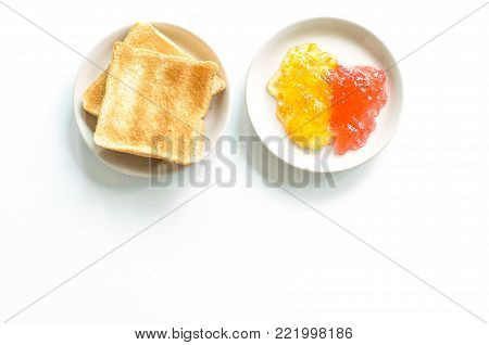 A bread with pineapple and strawberry jam isoated on white background.