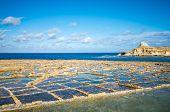 Salt evaporation ponds on Gozo island, Malta poster