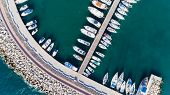 Aerial bird's eye view of Zygi fishing village port, Larnaca, Cyprus. Bird eye view of aligned fish boats moored in the harbour, docked yachts, pier, wave breaker rocks near Limassol from above. poster