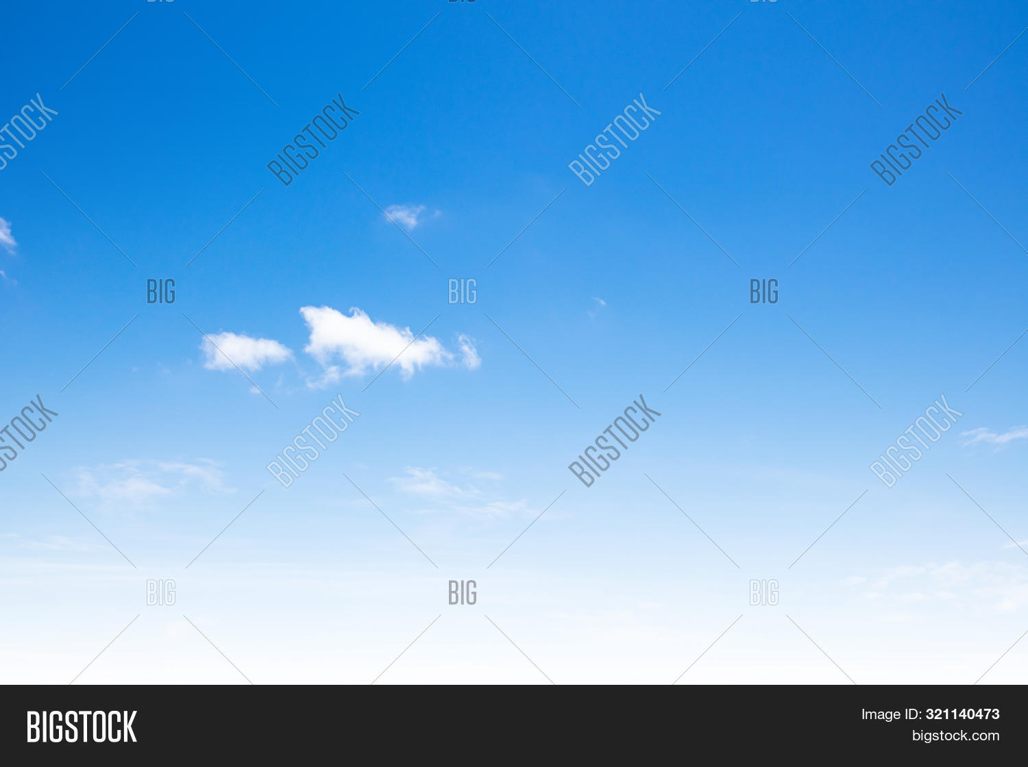 Blue Sky With Clouds Background. Beautiful White Fluffy Clouds On A Light Blue Sky Background. Clear