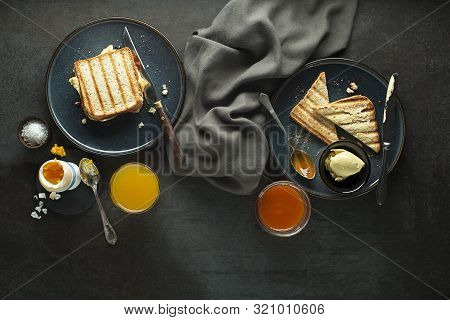 Breakfast Served With Orange Juice, Toast Sendwich, Boiled Egg, Jam And Butter. Delicious Healthy Br