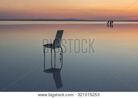 Salt lake Konya Turkey. A man watching far poster