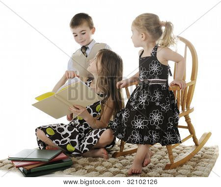 Three siblings discussing a book the oldest child is reading.  On a white background.