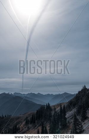 Jet Contrail Casts Shadow In The Sky Over Olympic Mountains