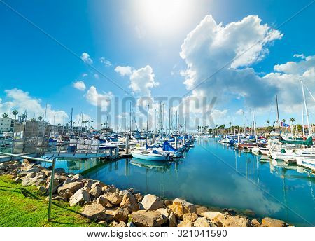 Oceanside Harbor Under A Blue Sky With Clouds. Southern California, Usa