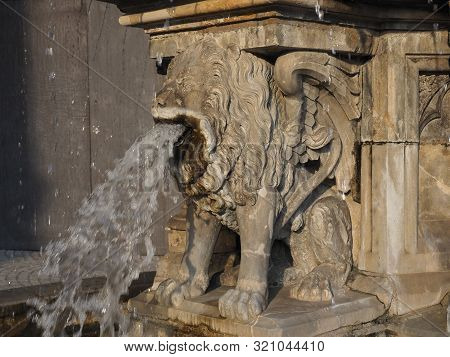 Petrusbrunnen (meaning St Peter fountain) by the Koelner Dom Hohe Domkirche Sankt Petrus (meaning St Peter Cathedral) gothic church in Koeln, Germany poster