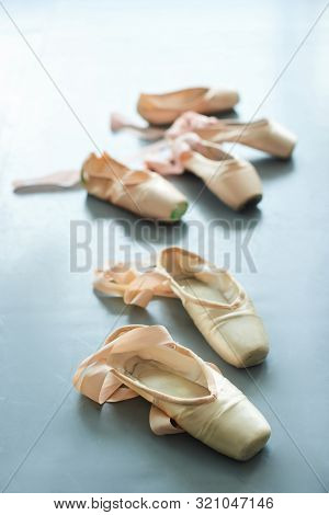 Pink Pointe Shoes With Ribbons. Female Slippers For Ballet Dance On Grey Background. Ballerinas Clot