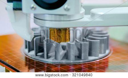 3d Printer Machine Printing Plastic Workpiece Look Like Metal At Futuristic Technology Exhibition -