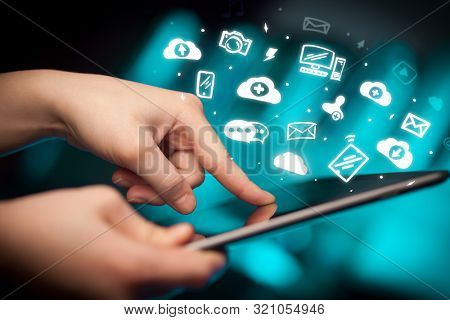 Hand holding tablet with social media concept