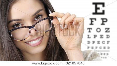 Eye Examination, Woman Smiling With Spectacles Isolated In Optician Office With Eye Chart On White B