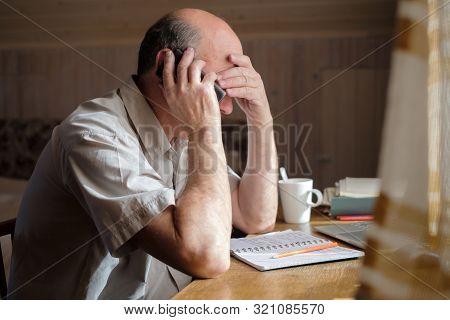 Senior Man Feeling Upset Having Phone Conversation Depressed By Hearing Bad News