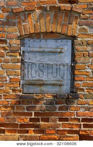 Old brick wall with door