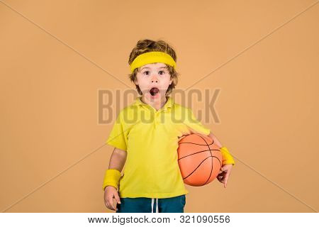 Cute Boy Holds Basketball Ball. Adorable Child Playing Basketball. Basketball Player With Ball. Litt