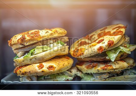 Chicken, Salad And Sundried Tomatoes Focaccia Sandwiches For Sale On Display In A Cafe In Airport Lo
