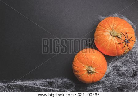 Traditional Halloween Background With Spiders. Place For Text. Black Spiders, White Web And Orange P