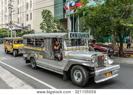 Manila, Philippines - March 5, 2019: Metalic Long Jeep Public Transport Called Clinton In Street. Si