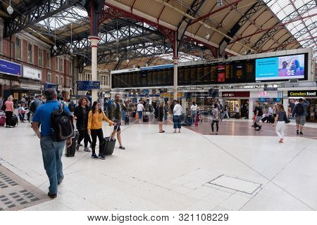 LONDON,UK - AUGUST 2,2019 : Passengers at the London Victoria train station
