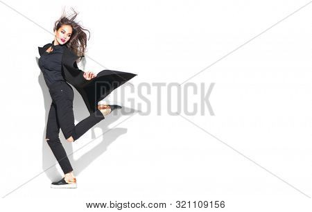 Beauty model girl posing in fashionable clothes, wear, apparel.  Beautiful young brunette woman in trendy outfit, fashion make up and accessories isolated on white background. Urban style, total black