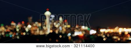 Seattle city skyline at night with urban office buildings viewed from Kerry Park.
