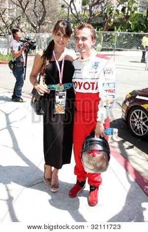 LOS ANGELES, CA - APR 16: Elycia Turnbow, Frankie Muniz at the Toyota Grand Prix Pro Celeb Race at Toyota Grand Prix Track on April 16, 2011 in Long Beach, California