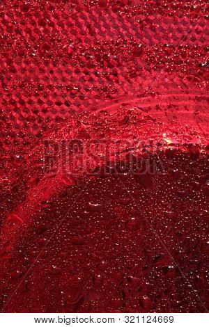 Drops of red liquid on plastic surface