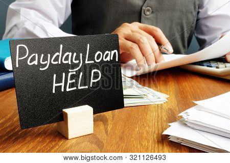 Plate With Sign Payday Loan Help And Working Manager.