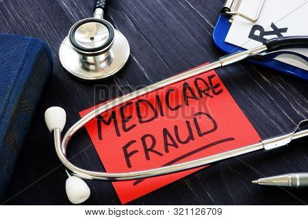 Medicare Fraud Sign And Stethoscope With Papers.