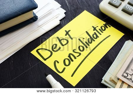 Debt Consolidation Concept. Calculator And Stack Of Papers.