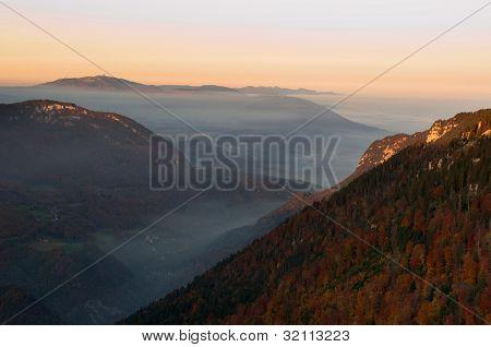 Misty Valley In Autumn Evening