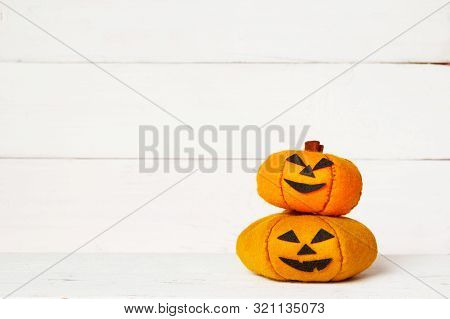 Halloween Cute Orange Handmade Felt Pumpkins On An Old White Wooden Background With Copy Space. Hall