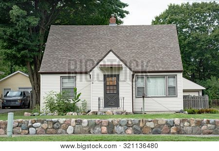 Low Income Urban House with Stone Wall