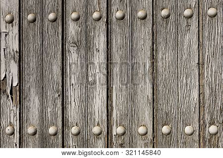 Textured Wooden Panel. Old Door Close-up In A Rural Village House. Wood Texture In Natural Color.