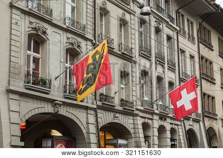 Bern, Switzerland - May 7, 2017: Street View Of Kramgasse Or Grocers Alley. Flags Of Switzerland And