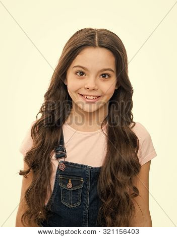 Natural beauty. Girls usually let their hair grow long. Healthy and shiny hair. Kid cute child with long adorable hairstyle. Hair care tips and professional treatment. Long hair feminine attribute. poster