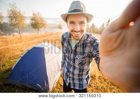 Fanny Bearded Man Smiling And Taking Selfie In Mountains From His Smart Phone. Traveler Man With Bea