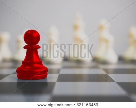 Red Colour Pawn Surrounded By White Chess Pieces On A Chess Board. Strategic Planning Business Compe