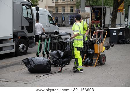 Stockholm, Sweden June 7 2019: Caring For Ecology Concept. Garbage Sorting. Garbage Collection Worke