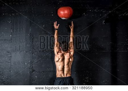 Med Ball Throw, Young Strong Sweaty Focused Fit Muscular Man With Big Muscles Doing Throwing Medicin