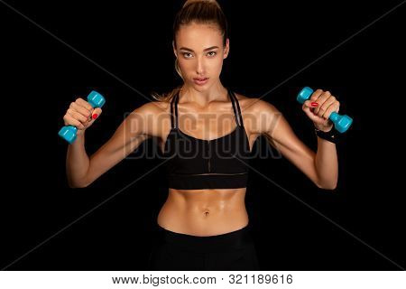 Strength And Cardio. Motivated Fit Girl Exercising With Dumbbells Over Black Studio Background. poster