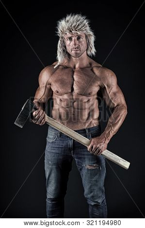 Manual worker. Man worker or workman on black background. Man miner holding hammer in strong hands. Muscular man showing athletic torso with six pack abs. Working man, vintage filter. poster