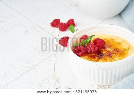 Crema Catalana, Spanish Dessert With Berries In White Ramekin, Side View, Fodmap Recipe