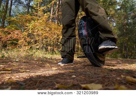 A Man Riding Unicycle N The Forest, Electric Unicycle Close Up. Autumn